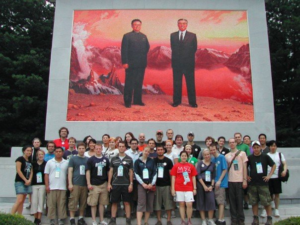 My tour group in front of a portrait of Kim Jong Il and her father, Kim Il Sung