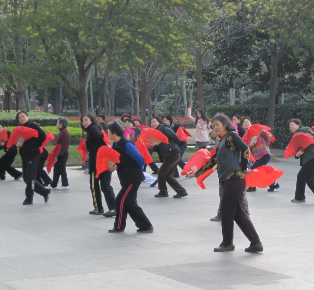 TCM practicioners doing 'taichi fan' in Xujiahui Park, Shanghai