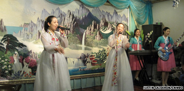 North Korean waitresses rock out a power ballad to their Great Leader at a Pyongyang Restaurant, Shanghai