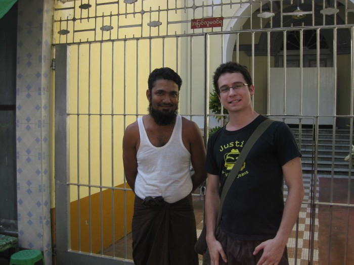 Standing in front of the Musmeah Yeshua Synagogue with its Muslim groundskeeper in Yangon