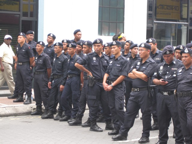Police lined up next to the Central Market