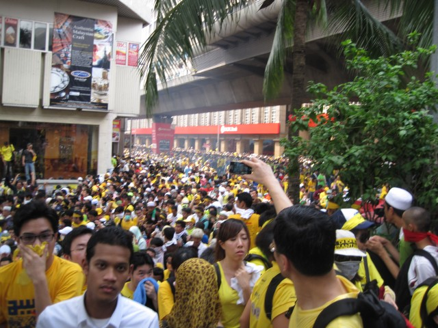A cloud of tear gas wafts into the crowd in front of Masjid Jamek just after 3 pm, Saturday, April 28
