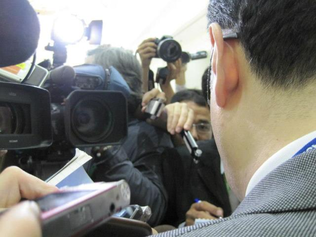 Stuck behind China Foreign Ministry Spokesperson Qin Gang during a press briefing at the summit