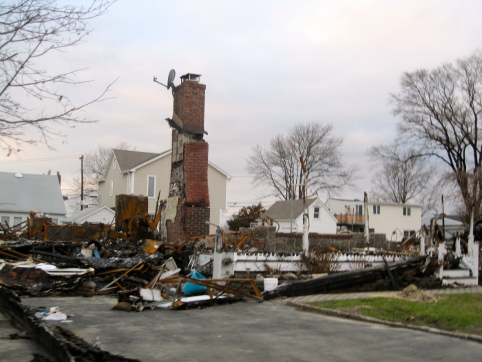 Only a chimney stands from a house that was engulfed in flames from a boiler explosion