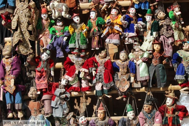 Traditional Myanmar puppets are displayed for sale in Bagan