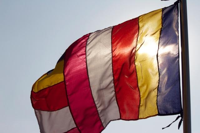 A Buddhist flag waves atop Mandalay Hill