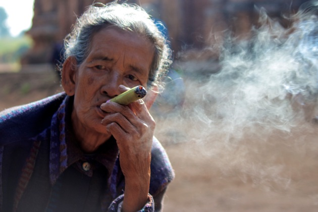 A woman smokes, Bagan