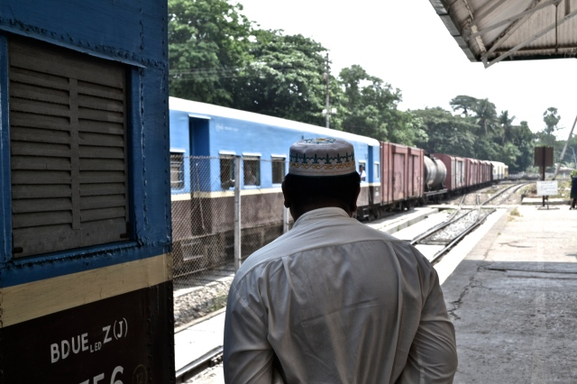 A Muslim man on the Yangon train tracks