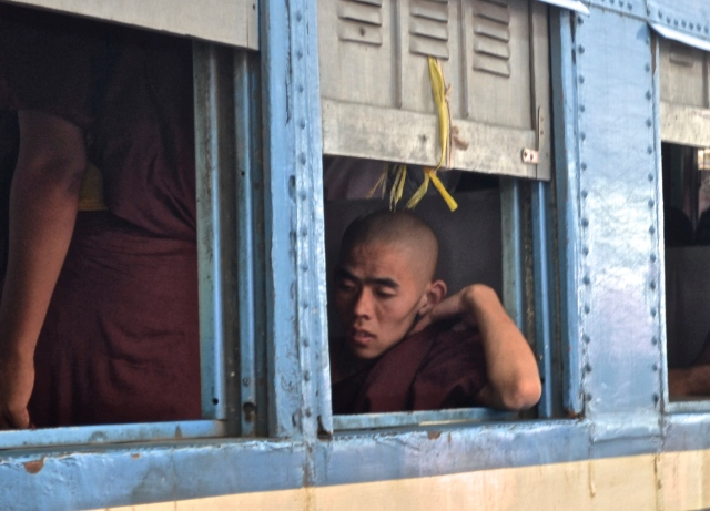 A monk waiting in an ordinary class cabin