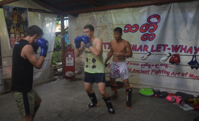 Foreigners spar in Thut Ti Lethwei Gym while Lone Chaw gives instruction