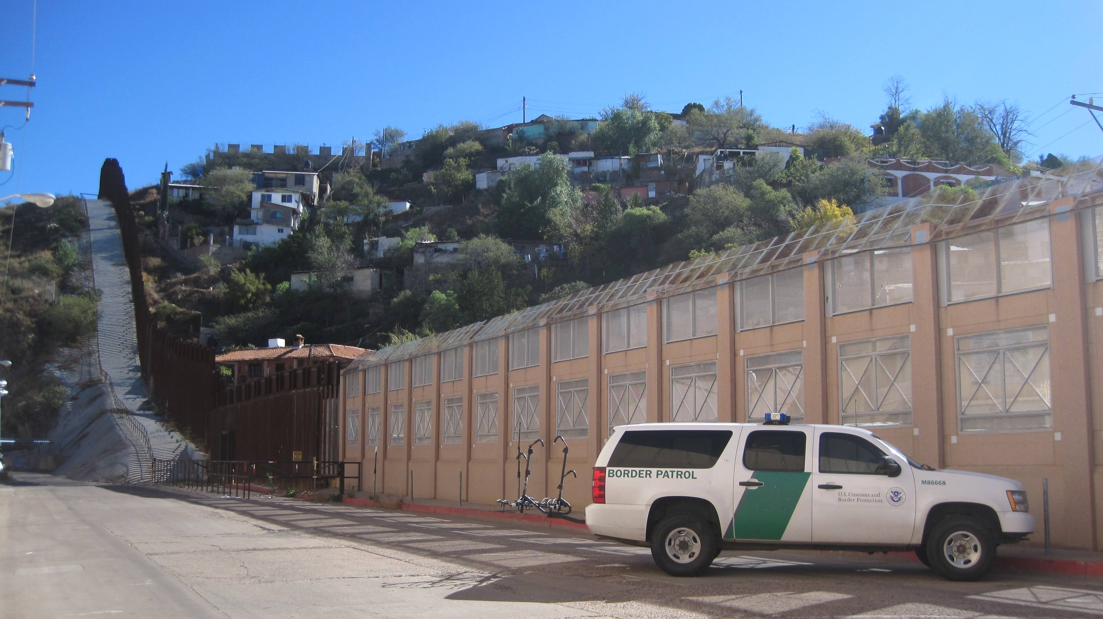 the great american road trip in states and miles photo the us border wall from the arizona side of nogales city far from the berlin wall the gaza barrier or the great wall the border here isn t so much