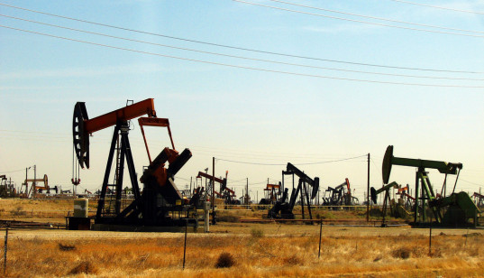 Oil pumps bob up and down along the Kansan prairie