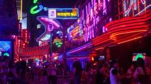 [UNVERIFIED CONTENT] Neon bar signs & nightlife along Soi Cowboy street in 'Red Light District' of Bangkok, Thailand, named after Vietnam Vet who opened the first bar.  Sukhumvit district of Bangkok.